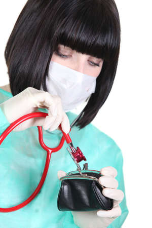 Nurse using stethoscope on purse photo