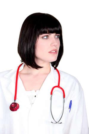 glancing: A doctor glancing sideways