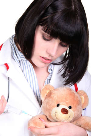 Nurse holding teddy bear photo
