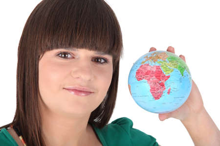 foreign policy: a young woman showing a little globe