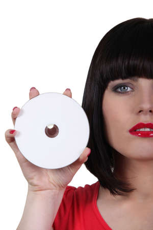 Closeup of a woman holding a compact disc photo