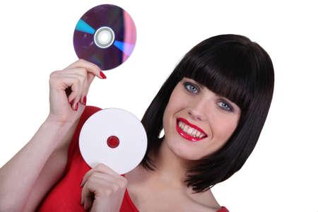 discs: Woman holding digital storage discs
