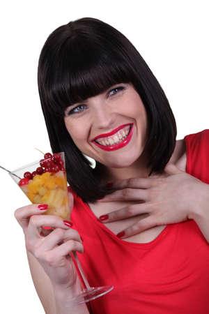 Brunette holding fruit-salad photo