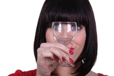 Woman watching meticulously an empty goblet Stock Photo - 18088827