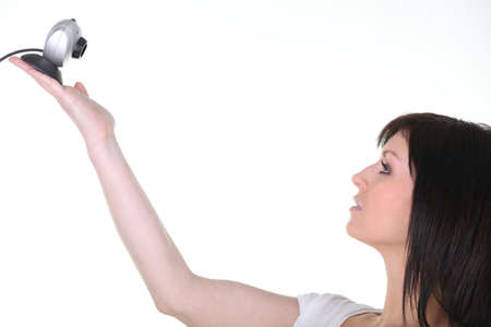 brunette in profile lifting up webcam Stock Photo - 18088248