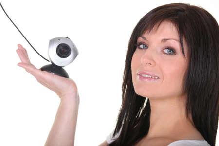 web cam: Woman holding web cam