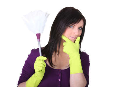 A maid with a feather duster photo