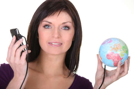 Woman with telephone plugged into globe photo