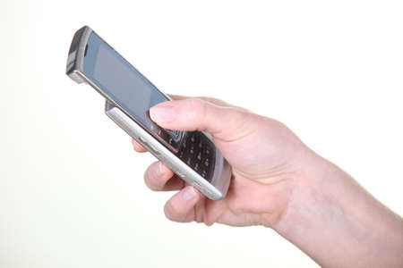 dialing: close-up of a hand using a cell phone Stock Photo