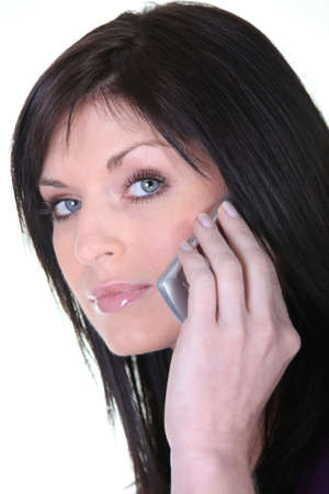 deadpan: Portrait of a woman talking on her mobile phone Stock Photo