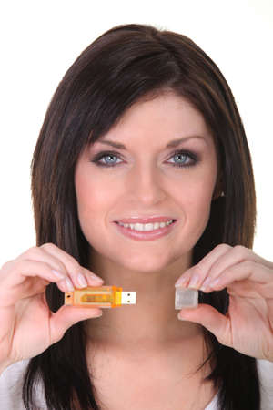 microdrive: Attractive woman showing USB key Stock Photo