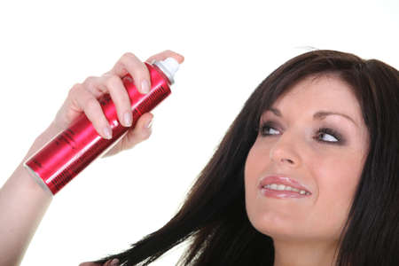 claims: Woman with bottle of hairspray