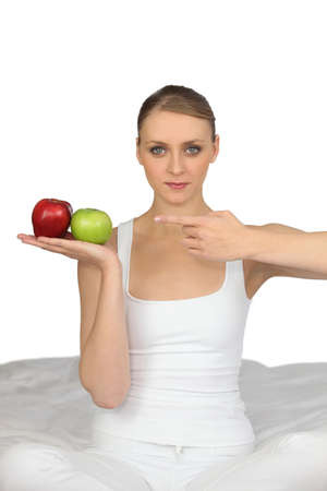 eat right: Woman pointing to apples