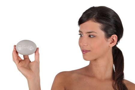 Woman holding soap bar photo