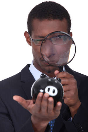 Man looking through a magnifying glass photo