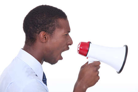 commotion: Side view of a man shouting into a megaphone