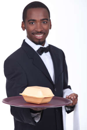 Waiter holding tray with fast food container photo
