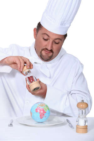 a cook seasoning a globe Stock Photo - 18100103