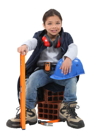 oversized: A little girl construction worker. Stock Photo
