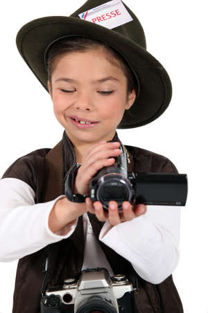 portrait of a little girl dressed as a photographer photo
