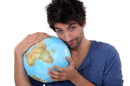 Handsome man hugging a globe photo