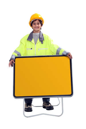 Young boy dressed as a construction worker photo