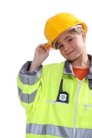10 15 years: Kid dressed up as a construction worker
