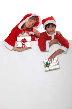 Brother and sister dressed in Santa Claus outfits Stock Photo - 18099703