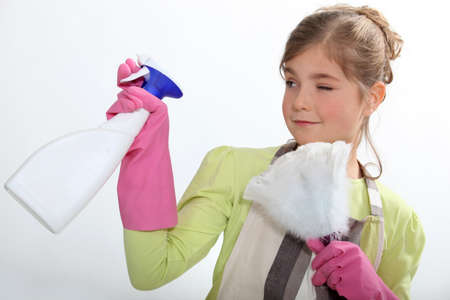 hair tied: Young girl cleaning