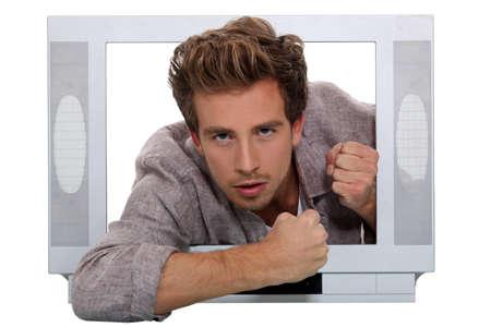 threatens: Man behind television frame