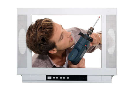 telly: Man drilling inside television