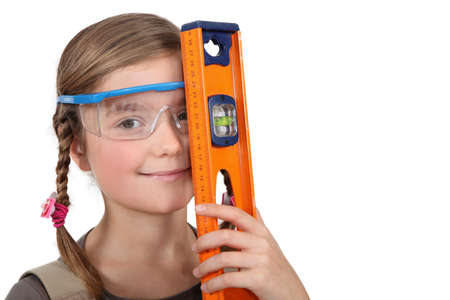 equalize: Little girl with spirit level