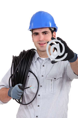 cable guy holding an at sign photo
