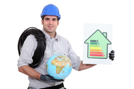 tradesperson: Electrician holding a globe and an energy efficiency rating sign Stock Photo