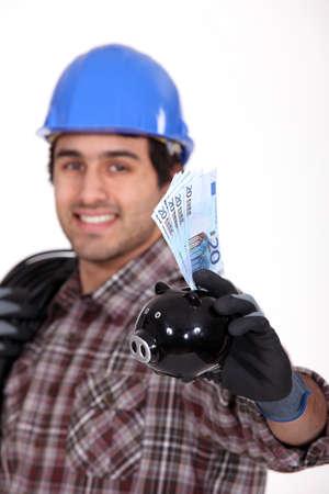 Entrepreneur showing piggy bank photo