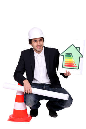 businessman holding a blueprint and an energy consumption label Stock Photo - 18088150