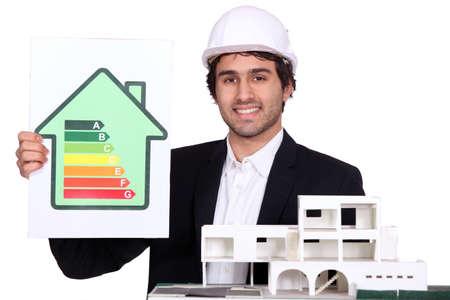 kwh: Architect holding model house