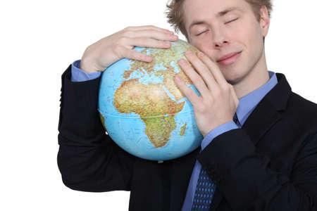 Podnikatel objímat zeměkoule