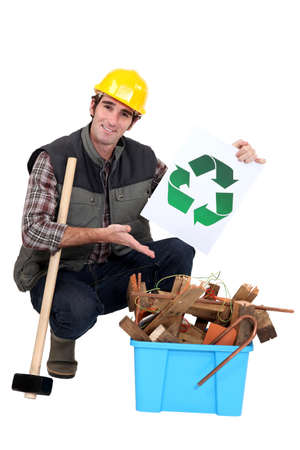 portrait of carpenter showing recycling logo photo