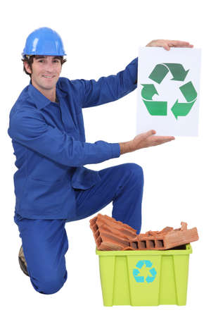 Builder holding recycle sign photo