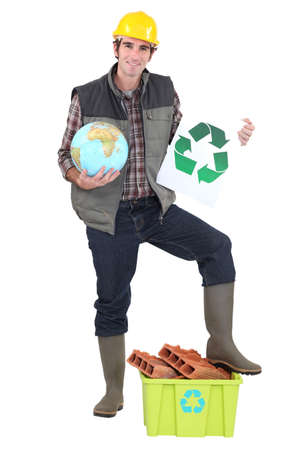 international recycle symbol: craftsman holding a recycling label Stock Photo