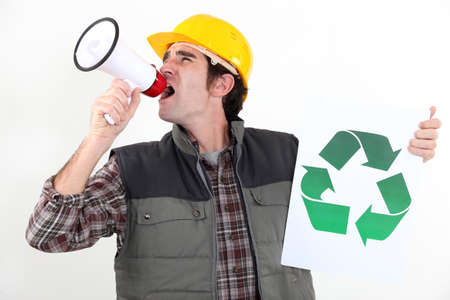 ecological problem: craftsman holding a recycling label and shouting through a megaphone