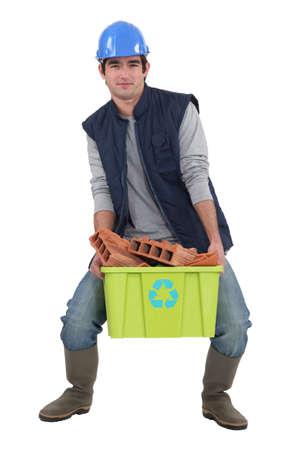 reprocess: Man recycling bricks Stock Photo