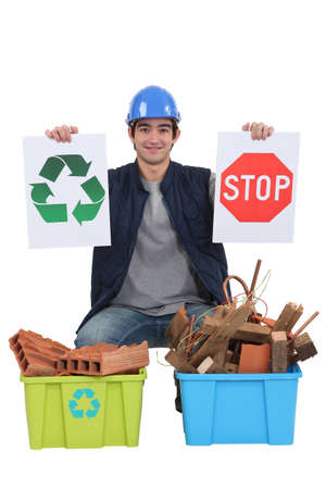 Construction worker encouraging people to recycle waste photo