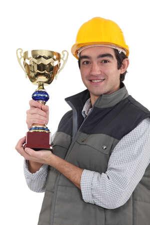 memorial plaque: Builder holding trophy