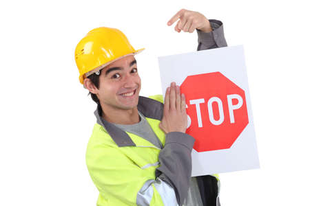 lugs: Traffic worker pointing to stop sign