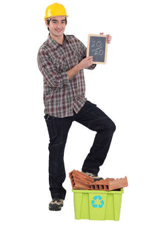 Laborer showing slate, studio shot photo