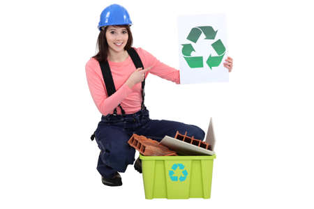 corporate waste: Female builder Stock Photo