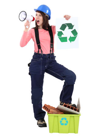 craftswoman holding a megaphone and a recycling label photo