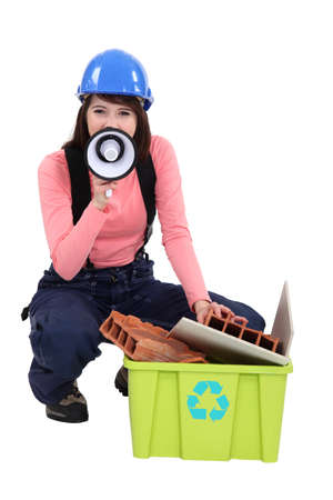 promoting: A female construction worker promoting recycling. Stock Photo